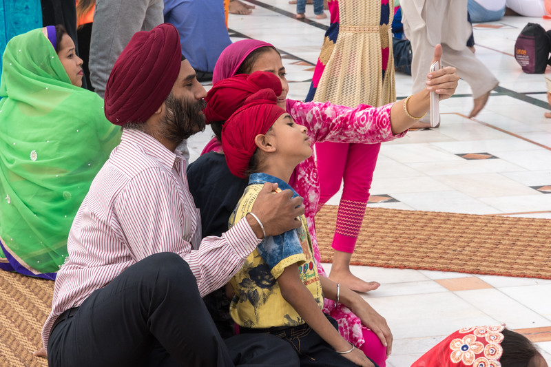 A family takes a selfie at the Sikh temple in Delhi.