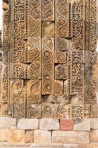 Carvings on an ancient mosque, Qutb Minar, Delhi.