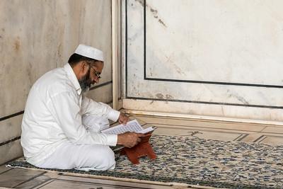 A man reads the Quran, Jama Masjid, Delhi.