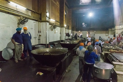 Volunteers prepare food for hundreds of visitors to the Sikh temple in Delhi.