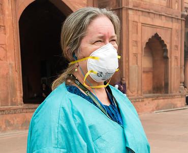Pam sports a smog mask while visiting  Jama Masjid, Delhi.