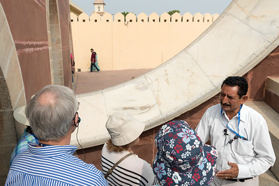 A guide explains a sundial at Jantar Mantar observatory - Jaipur.