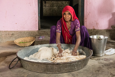A woman prepares the childrens' mid-day meal at the public school.