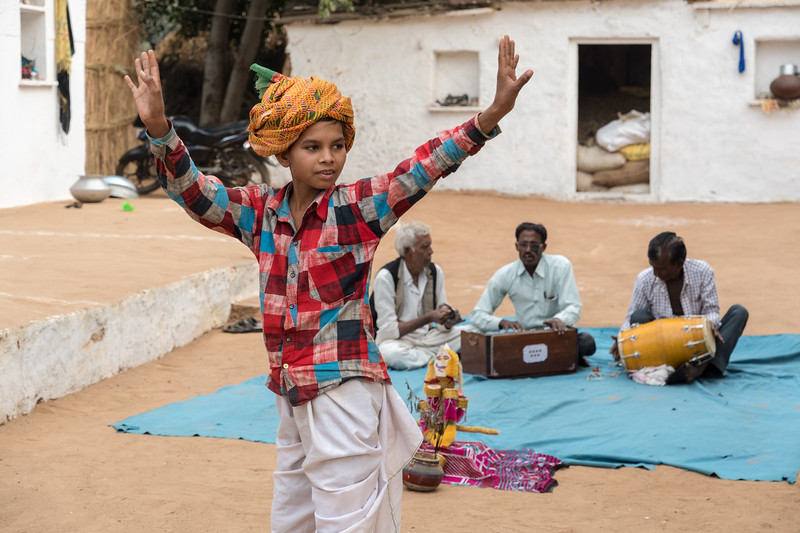 A boy demonstrates a traditional wedding dance.