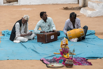 Men play music for the dance presentation.