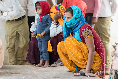 Villagers watch the dance presentation.