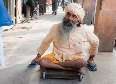 A disabled man in the Jaipur bazaar.