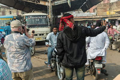 Val photographs the locals while a local takes a selfie with Val - village of Lalsot, Rajasthan.