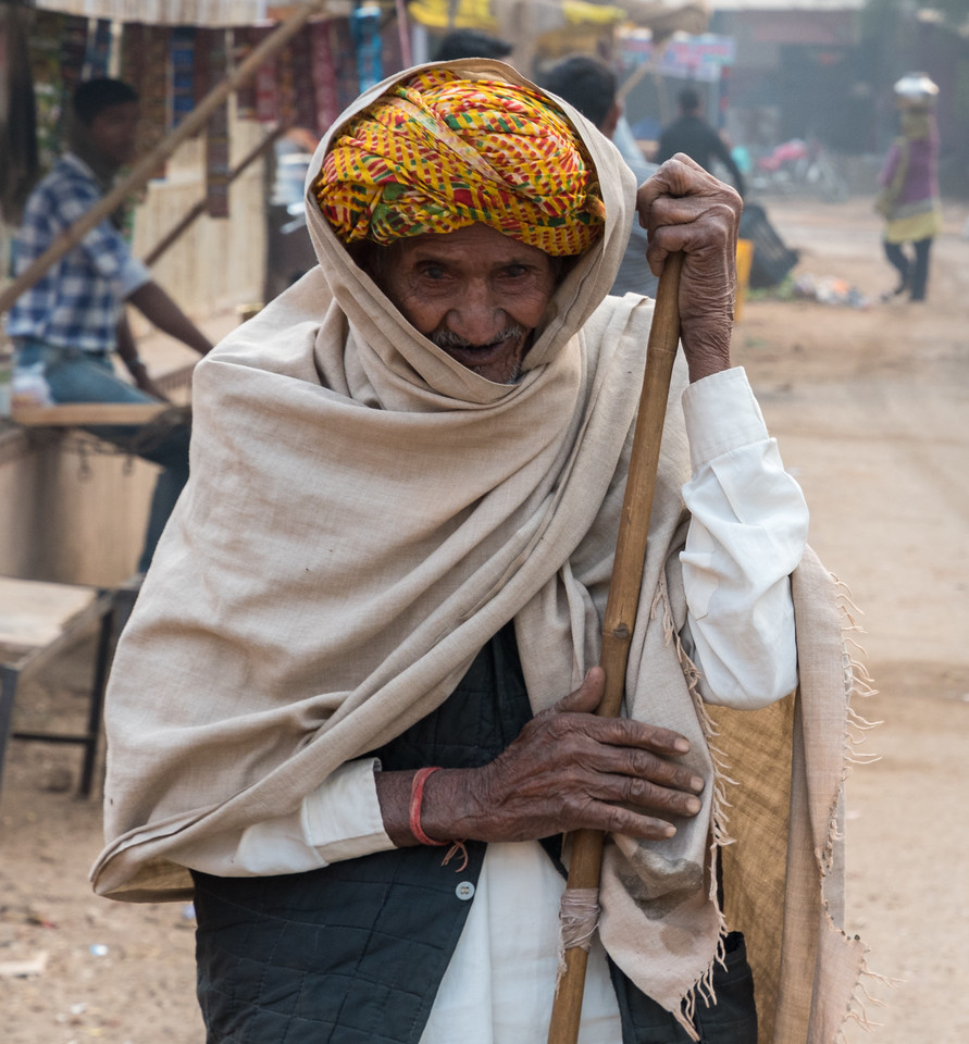 An elderly villager greets us as we walk toward the Chand Baori step well.