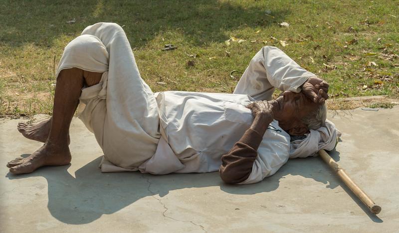 An elderly man rests at Sarnath, Varanasi.
