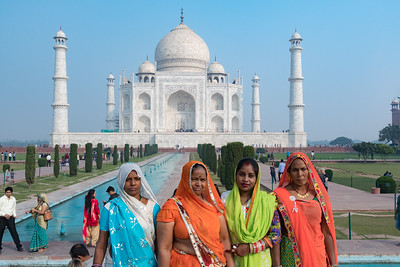 A group of women pose for a photo at the Taj Mahal.