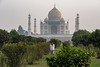 View of Taj Mahal from across the Yamuna River at Mahtab-Bagh gardens.