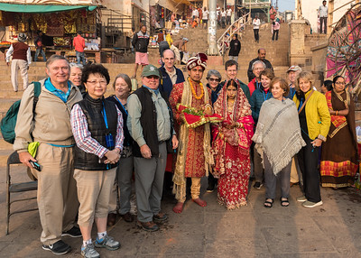 The Dartmouth group poses with a newlywed couple on the ghats at Varanasi. L to R: Dave, Sue, Eileen, Pam, Bob, Sam, groom, Stephanie, bride, David, Kip, Mary, Renata, Val, Reena.