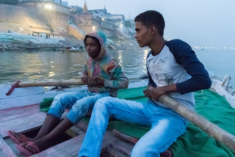 A boy helps to row our boat down the Ganges.