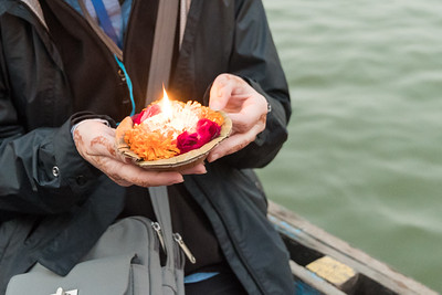 Sue prepares an offering of candle and flowers to float on the Ganges River, Thanksgiving morning.