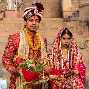 Newlywed bride and groom visit the ghat in Varanasi.