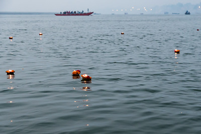 Offerings of candle and flowers float on the Ganges River, Thanksgiving morning.