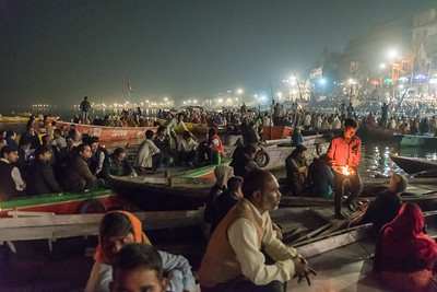 Hundreds of tourists observe the Aarthi ceremony at Varanasi.