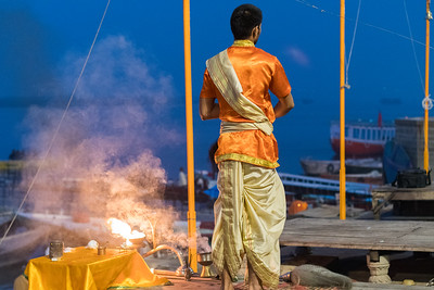 A Brahman priest prepares a sunrise ceremony on the ghat in Varanasi.