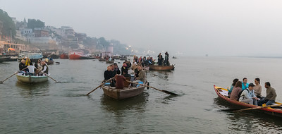Many tourists in boats, like ours, touring the Varanasi ghat at sunrise.