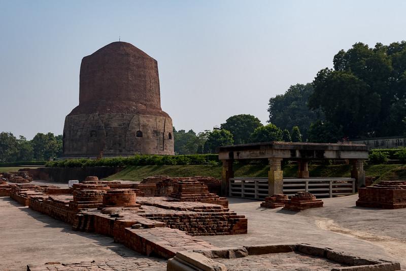 Mulagandha Kuti, the remains of a huge temple where Buddha used to meditate - with Dhamekh Stupa at rear - Sarnath, Varanasi.