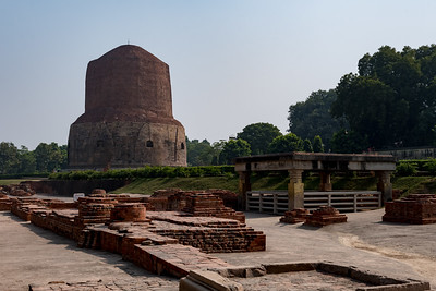 Mulagandha Kuti, the remains of a huge temple where Buddha used to meditate - with Dhamekh Stupa at rear - Sarnath, Varanasi.