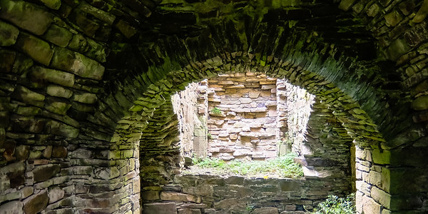 Interior archway in the kitchen area of Jerpoint Abbey. Much of the mortar is eroded away but the design of arches can last quite long based on pressure.