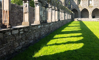View from the cloister courtyard towards the main residence hall at Jerpoint Abbey.