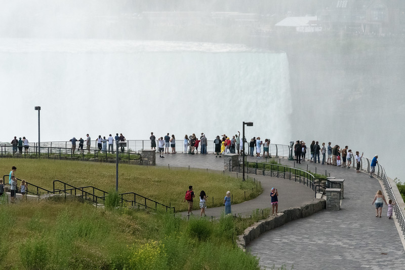 People viewing Horshoe Falls from the American side of Niagara Falls.