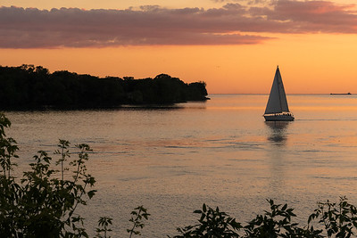 Sailboats returning to port past Fort Niagara, on Lake Ontario.