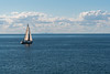 Sailboat on Lake Ontario, seen from Fort Niagara, with Toronto in the background.