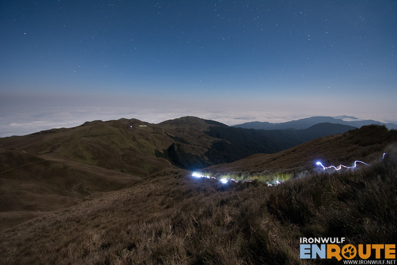 Trail lights from incoming climbers