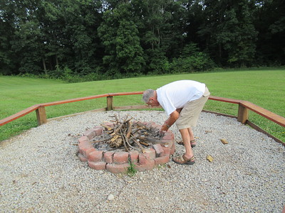 Dad getting the firepit ready.