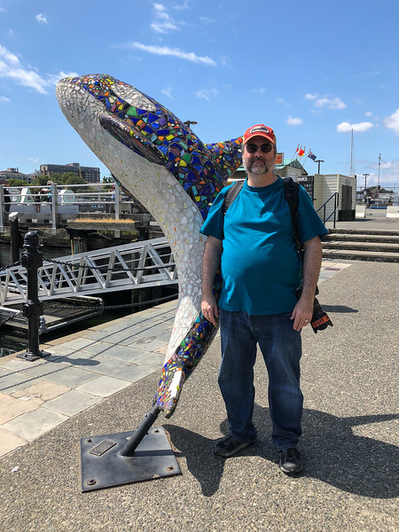 Dave posing with a mosaic killer whale in Victoria