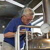 Bob inspects one of the brewing tanks