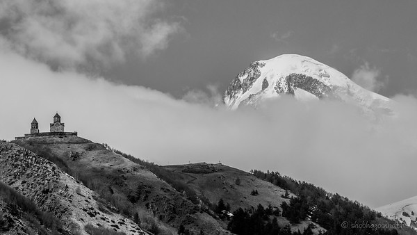 Gergeti Trinity Church and the peak of Mt Kazbek
