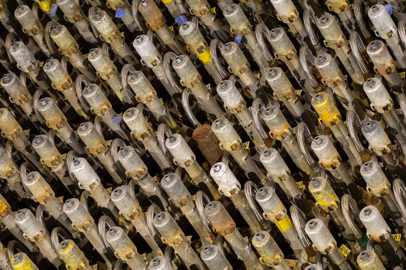 """Each one of these tubes was loaded with uranium """"slugs"""" (with inert graphite slugs at the ends). When the reaction was done, the slugs were pushed out through the back side of the reactor as the next batch was loaded."""