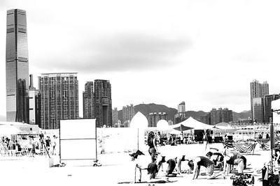 Harbor yoga. Hong Kong 2018. Photo by Weldon Weaver.