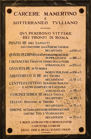 """A list of some of the the most famous inmates of the Tullianum. <br /> <br /> The title of the plaque says """"Carcere Mamertine and Underground Tulliano, Here perished victims of the triumphs of Rome"""".  Two notable victims are Sejanus, chief administrator for the Emperor Tiberius and a suspect in a plot to overthrow Tiberius, and Vercingetorix, the Gallic general who was conquered by Julius Caesar."""