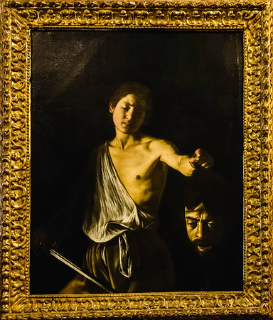 """David with the Head of Goliath by Carravagio.  This painting is on the first floor of the Borghese Museum along with other Carravagio paintings.  It is a complex work that is further complicated by its connections to the complicated life of Carravaggio.  The head of Goliath is Carravaggio's self portrait and the face of David is modeled on a studio assistant with whom Carravvaggio may have had a sexual relationship.  <br /> <br /> A good place to start finding out about the commplexity of this work is <a href=""""https://en.wikipedia.org/wiki/David_with_the_Head_of_Goliath_"""">https://en.wikipedia.org/wiki/David_with_the_Head_of_Goliath_</a>(Caravaggio,_Rome))"""