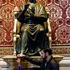 Statue of St. Peter<br /> <br /> Tourists  customarily rub the toe of the statue<br /> <br /> St. Peter's Basilica<br /> <br /> Vatican City