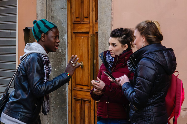 The second morning I was in Rome, I went out in the morning for a walk in the Monti district.  I saw this African immigrant talking with two young women.