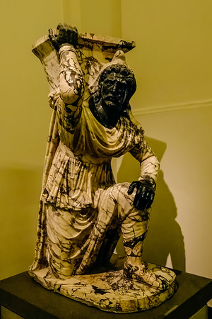 Kneeling Barbarian <br /> <br /> Note the head of black marble<br /> <br /> Early 1st century AD<br /> <br /> Archaeological Museum of Naples