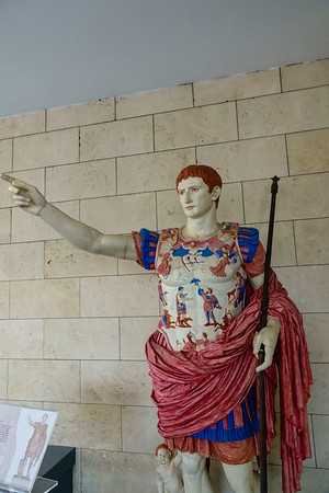 Roman sculptures were not just the bare marble that we see today.  They were in fact painted.  This example from the Vatican Museums in Rome shows how they might have looked.