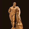 Farnese Hercules<br /> <br /> The Farnese Hercules is an ancient statue of Hercules, probably an enlarged copy made in the early third century AD and signed by Glykon, who is otherwise unknown; the name is Greek but he may have worked in Rome. Like much Ancient Roman sculpture it is a copy or version of a much older Greek original that was well-known, in this case an original by Lysippos (or one of his circle) that would have been made in the fourth century BC. The enlarged copy was made for the Baths of Caracalla in Rome (dedicated in 216 AD), where the statue was recovered in 1546. <br /> <br /> This statue is about 10.5 feet tall.<br /> <br /> Archaeological Museum of Naples<br /> <br /> Naples, Italy