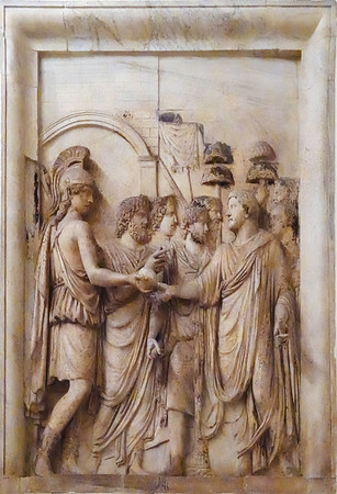 A bas-relief from the Arch of Marcus Aurelius.  As a collection these bas-reliefs were designed to show the Emperor carrying out duties and activities that were to be viewed as appropriate to his station.<br /> <br /> I am not sure what he is doing here.  Perhaps he is soldiering.