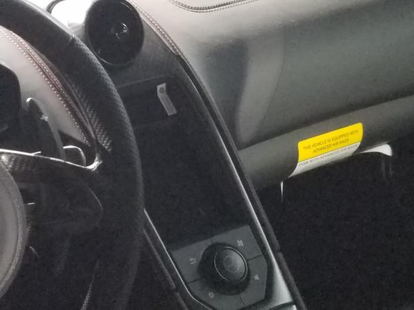 This McLaren P1 dash still has the plastic screen protector on it.