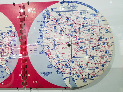 It's like a slide rule for calculating distances between cities.