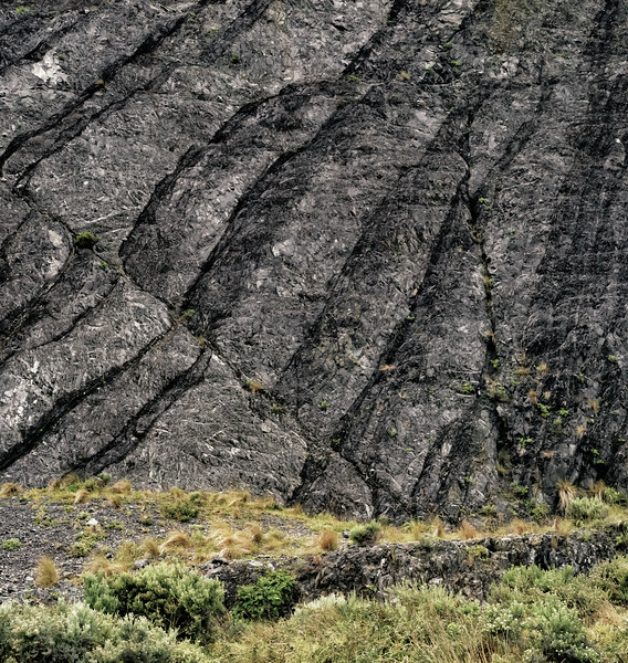 "2018-03-24 Stone formation showing the uplift of various layers from horizontal to a 45 degree angle.  Taken near Red Rocks Walkway in the vicinity of Te Kopahou Visitor Center and about 9 km SW of Wellington, New Zealand. Coords: 41°20'47"" S 174°44'45"" E   See https://www.gns.cri.nz/Home/Learning/Science-Topics/Earthquakes/Major-Faults-in-New-Zealand/Wellington-Fault"