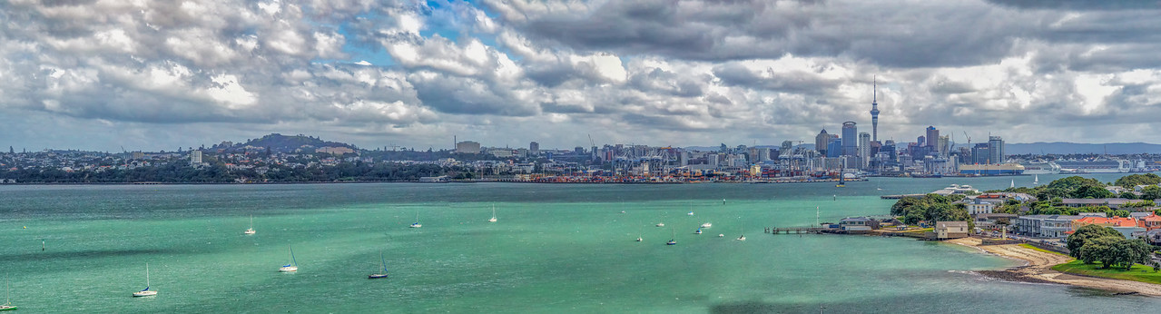 """2018-03-13 Auckland panorama, """"Sky Tower"""" is the tallest structure in photo. As the crow flies, it is 3 miles to the SW of where photo was taken. """"It is 328 metres (1,076 ft) tall, as measured from ground level to the top of the mast, making it the tallest freestanding structure in the Southern Hemisphere and the 23rd tallest tower in the world. It has become an iconic landmark in Auckland's skyline due to its height and unique design."""""""
